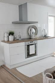 best ideas about contemporary small kitchens pinterest tiny white contemporary kitchen with wooden countertop upper cabinets