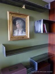 Free Floating Shelves by Cantilevered Free Floating Metal Shelves