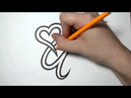 letter q and heart combined tattoo design ideas for initials