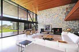 floor to ceiling windows contemporary fireplace coffee table