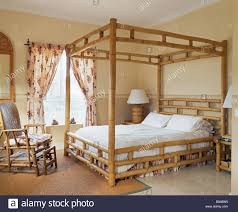 bamboo four poster bed and chair in spanish bedroom floral