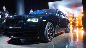 roll royce logo the rolls royce black badge wraith is peak selfie magnet slashgear
