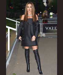 cheryl wows in black thigh high boots and off the shoulder black