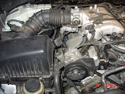 how do you change kia sorentos spark plugs