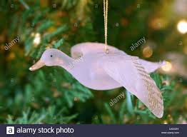 flying goose ornament hanging on tree stock photo