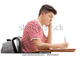 Picture Of Student Sitting At Desk Boy Studying Stock Images Royalty Free Images U0026 Vectors