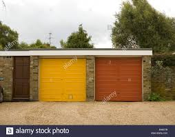 suburban garage doors in 70 u0027s style stock photo royalty free