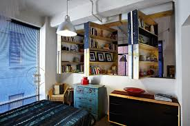 Bookcases As Room Dividers The Amazing Revolving Unwaste Bookcase Room Divider Apartment