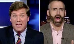 is tucker carlson s hair real moment fox news host loses it with clintonite who claims hillary