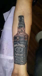realistic jack daniel bottle tattoo on forearm