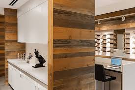 weathered wood wall reclaimed wood walls at retail eyeglass store anthology woods