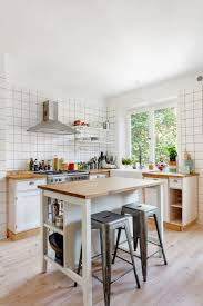 kitchen island carts adding essential space to your kitchen beautiful white small kitchen ideas with traditional cabinet also wooden countertop wallmount range hood grey barstool