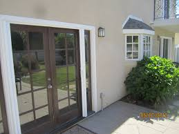 Exterior Design Awesome Brown Retractable Screen Door With Silver