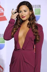 demi lovato earrings demi lovato in a plunging plum gown for grammy awards