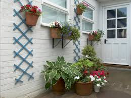 Self Watering Wall Planters Arranging Potted Plants Patio Google Search Gardening Ideas