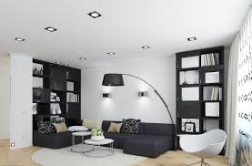 living room black leather sectional sofa and cow skin rugs to