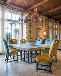 crystal chandelier dining room atlanta square pedestal table dining room mediterranean with beam