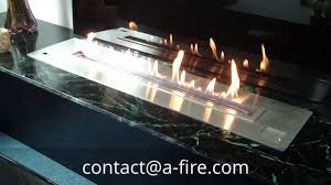 install your design fireplace with a remote ethanol burner afire