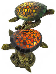 zeckos tiffany style swimming sea turtles lamp amber and green