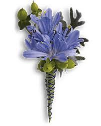 blue boutonniere bold and blue boutonniere teleflora