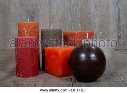 several ornamental candles of different colors stock photo