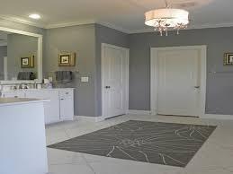 gray wall paint chandelier rug carpet on white ceramic flooring