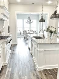 White Kitchen Tile Floor I M Obsessed With This White Kitchen The Pendant Lights And Wood