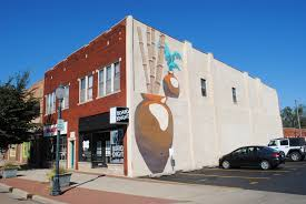 murals shop merchant street shop merchant street located on the east side of the current board knights building on 228 west main street this mural was created by jacob manning with help from jason sims