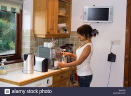 electric kitchen appliances teenager or young woman using array of electrical kitchen