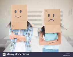 digital composite of couple with box heads sad and happy against