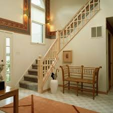 foyer entryway with wooden staircase railing reinforce a