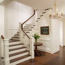 staircase staircase traditional with dark stained wood paneled walls