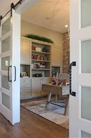 office cabinets with doors office with sliding barn doors and gray painted built in wall