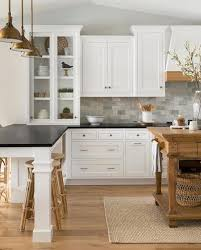 white cabinets with black countertops and backsplash 25 trendy contrasting countertops for your kitchen digsdigs