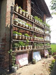 self watering vertical garden with recycled water bottles 6 steps