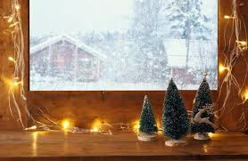 window sill with christmas lights in front of winter landscape