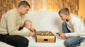 family table football at home stock footage 3545579