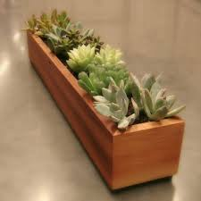modern wood planter google search for communications team
