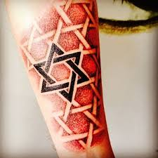 this is a tattoo using pointillism to create his forearm of jewish