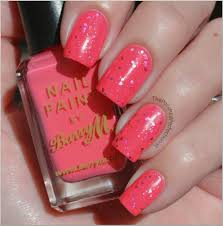 the polished perfectionist bright pink glitter nails