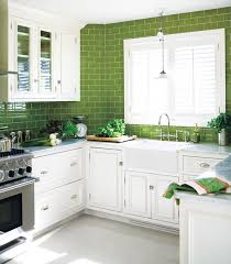 kitchen with white cabinets and green subway tile to the ceiling