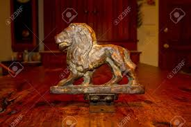 antique bronze lion an antique bronze lion statue photographed on an wooden table