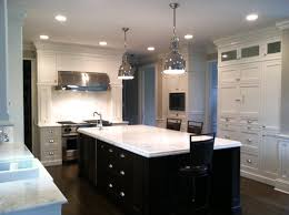 kitchen with black island and white cabinets white kitchen cabinets with island walzcraft