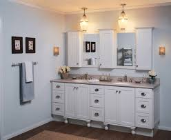 bathroom cabinet ideas for your stylish storage solution amaza shiny bathroom cabinet ideas implemented with two wall mirrors enlightened floating lamps