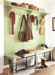 light green wood entryway bench seat design with coat rack and