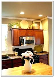 whats on top of your kitchen cabinets home decorating top of cabinet decor cheriedinoia com