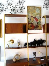 great custom open cabinetry with modern wall shelves as craft