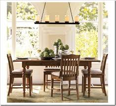 how high to hang chandelier over dining table lighting height guide sand and sisal