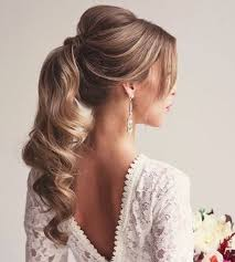 ponytail bump 30 eye catching ways to style curly and wavy ponytails