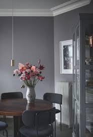 design attractor dark painted walls inside of an amazing scandinavian apartment dining room